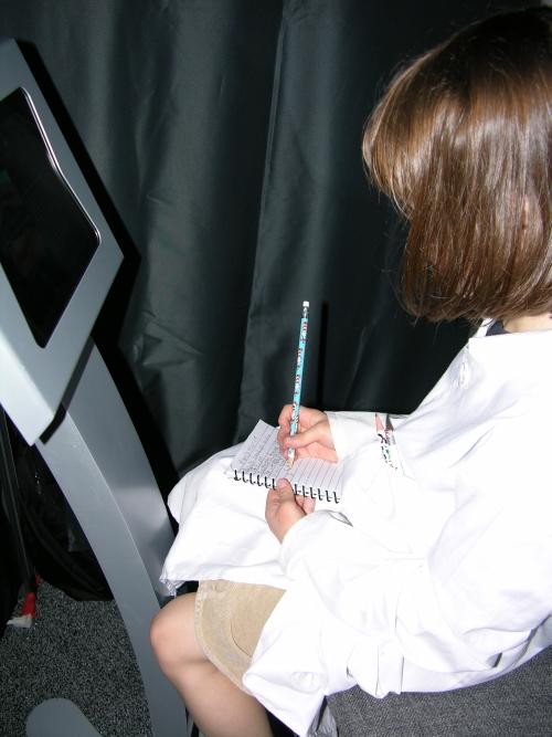 Peo taking notes at iPad 1